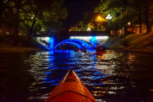 Night kayaking in Daugavas River, Riga, Latvia