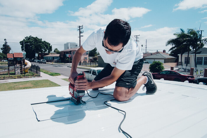 DIY promaster camper van conversion cutting roof for fan
