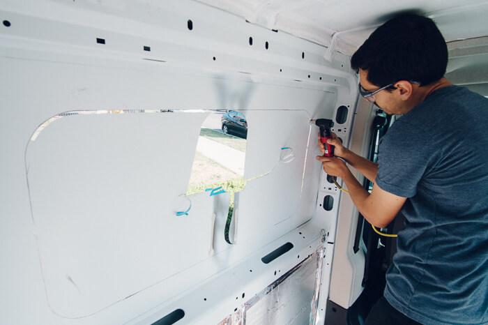 DIY promaster campervan conversion window cutting