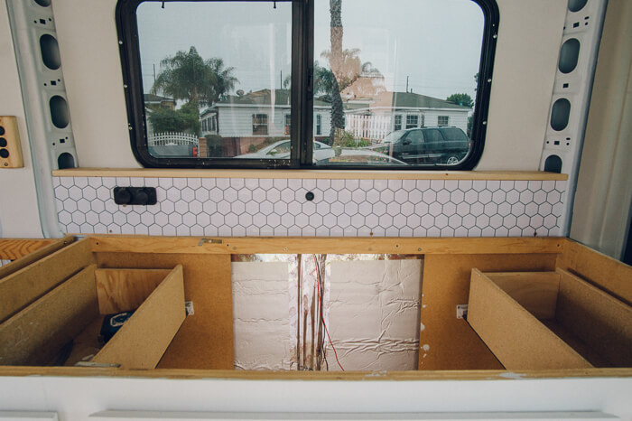 campervan kitchen beehive backsplash